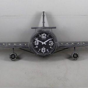 Grote vliegtuig klok in de kleur donker grijs.
